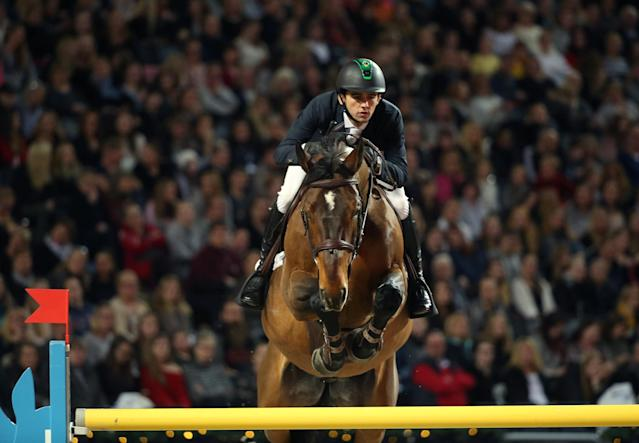 Equestrian - Sweden International Horse Show - International jumping - Qualification for Sweden Masters - Friends Arena, Stockholm, Sweden - December 1, 2017. Marlon Modolo Zanotelli on his horse Rock'N Roll Semilly jumps. TT News Agency/Soren Andersson/via REUTERS ATTENTION EDITORS - THIS IMAGE WAS PROVIDED BY A THIRD PARTY. SWEDEN OUT. NO COMMERCIAL OR EDITORIAL SALES IN SWEDEN