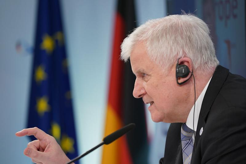 BERLIN, GERMANY - JULY 07: German Interior Minister Horst Seehofer speaks to the media via video conference following a virtual informal meeting of European Union interior ministers during the novel coronavirus pandemic on July 07, 2020 in Berlin, Germany. The meeting, which is being held via video monitors, concentrated on the rescue of migrants at sea and the cooperation of EU member states police forces. Germany is hosting the conference as part of its current presidency of the European Council. (Photo by Sean Gallup/Getty Images)