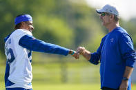 Indianapolis Colts head coach Frank Reich greets wide receiver Tyler Vaughns before the start of practice at the NFL team's football training camp in Westfield, Ind., Monday, Aug. 2, 2021. Reich returned to practice following his quarantine period and two negative tests after a positive test for COVID-19. (AP Photo/Michael Conroy)