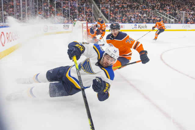 St. Louis Blues' Zach Sanford (12) races to the puck in front of Edmonton Oilers' Ethan Bear (74) during the first period of an NHL hockey game Wednesday, Nov. 6, 2019, in Edmonton, Alberta. (Amber Bracken/The Canadian Press via AP)