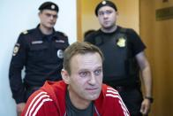 FILE - In this Aug. 22, 2019, file photo, Russian opposition leader Alexei Navalny speaks to the media prior to a court session in Moscow, Russia. The return of Navalny from Germany on Jan. 17, 2021, after he spent five months in Berlin recovering from a nerve agent poisoning was marked by chaos and popular outrage, and it ended, almost predictably with his arrest. (AP Photo/Alexander Zemlianichenko, File)