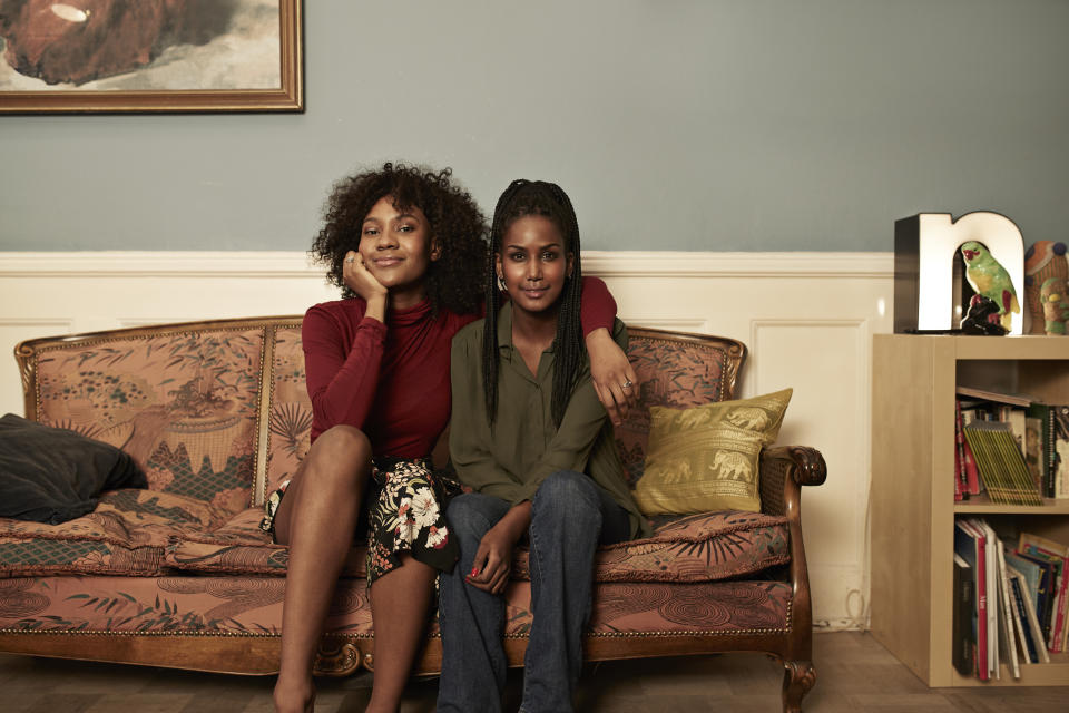 Two young women in sofa at home