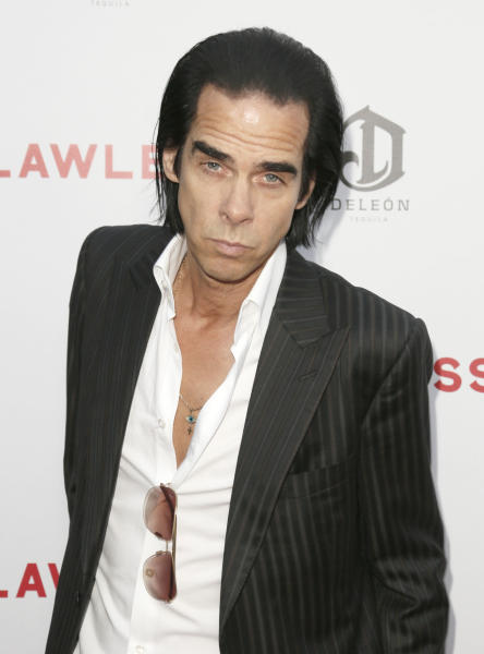 "FILE - This Aug. 22, 2012 file photo shows Nick Cave attending the LA premiere of ""Lawless"" at Arclight Cinemas Hollywood in Los Angeles. Cave, the Australian singer-songwriter, has gradually expanded beyond music into fiction, poetry and screenwriting. ""Lawless,"" which stars Shia LaBeouf and Tom Hardy, is his second film with director John Hillcoat following the even bloodier Aussie Western ""The Proposition."" (Photo by Todd Williamson/Invision/AP, file)"