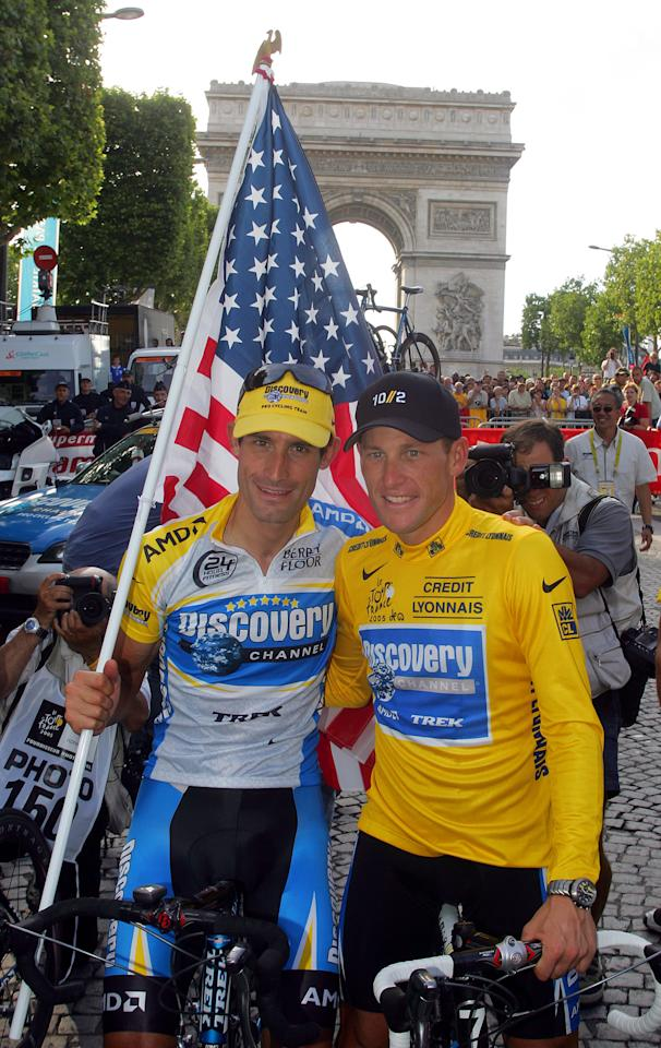 "FILE - In this July 24, 2005 file photo, Lance Armstrong, right, and his Discovery team colleague George Hincapie pose for photographers on the Champs Elysees during a victory parade after Armstrong won his 7th straight Tour de France cycling race in Paris. A report by ""60 Minutes"" says Hincapie, a longtime member of Lance Armstrong's inner circle, has told federal authorities he saw the seven-time Tour de France winner use performance-enhancing drugs. A segment of the report aired Friday night, May 20, 2011 on the ""CBS Evening News."""