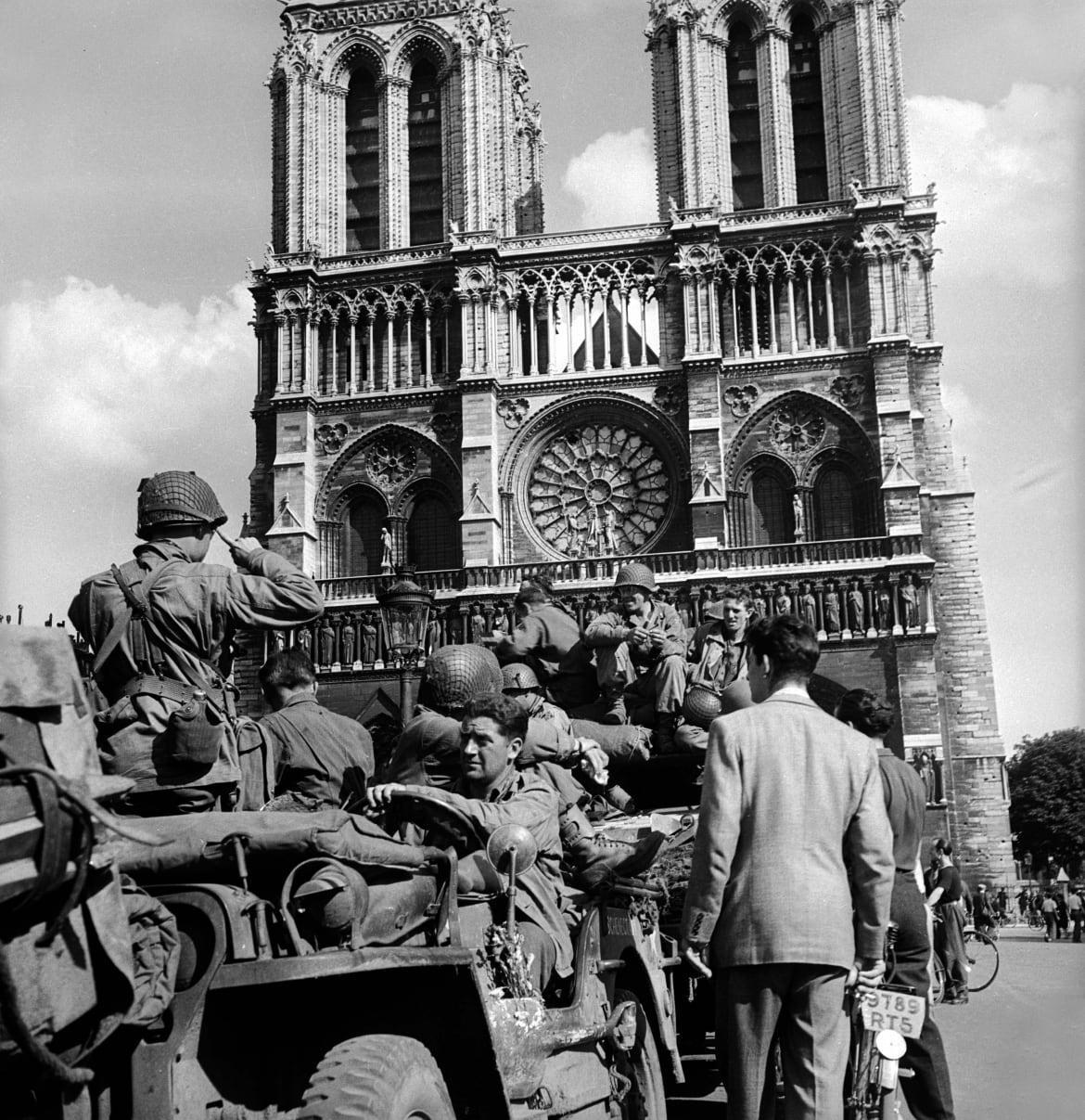 """<div class=""""inline-image__caption""""> <p>Liberation of Paris. American soldiers on the Notre Dame of Paris square, Aug. 25, 1944.</p> <br> </div> <div class=""""inline-image__credit""""> Pierre Jahan/Roger Viollet/Getty </div>"""