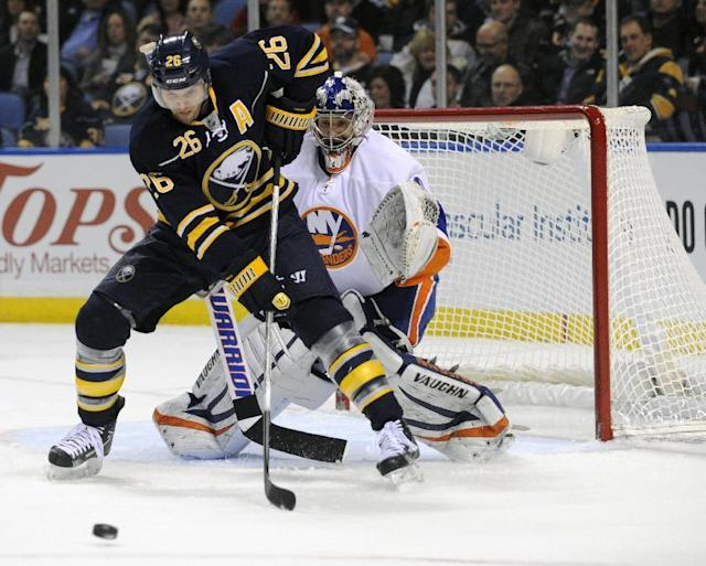 FILE-Buffalo Sabres' left winger Thomas Vanek (26), of Austria, gets ready to deflect the puck in front of New York Islanders' goaltender Evgeni Nabokov (20), of Russia, during the first period of an NHL hockey game in Buffalo, N.Y., Saturday, Feb. 23, 2013 The New York Islanders announced Sunday Oct. 27, 2013, that they have acquired Vanek from the Buffalo Sabres in exchange for Matt Moulson, a first round selection in the 2014 NHL draft and a second round selection in 2015. (AP Photo/Gary Wiepert)