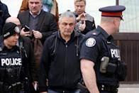 <p>Vic Minassian, the father of suspect Alek Minassian leaves court after his son's court appearance in Toronto. LARS HAGBERG/AFP/Getty Images </p>