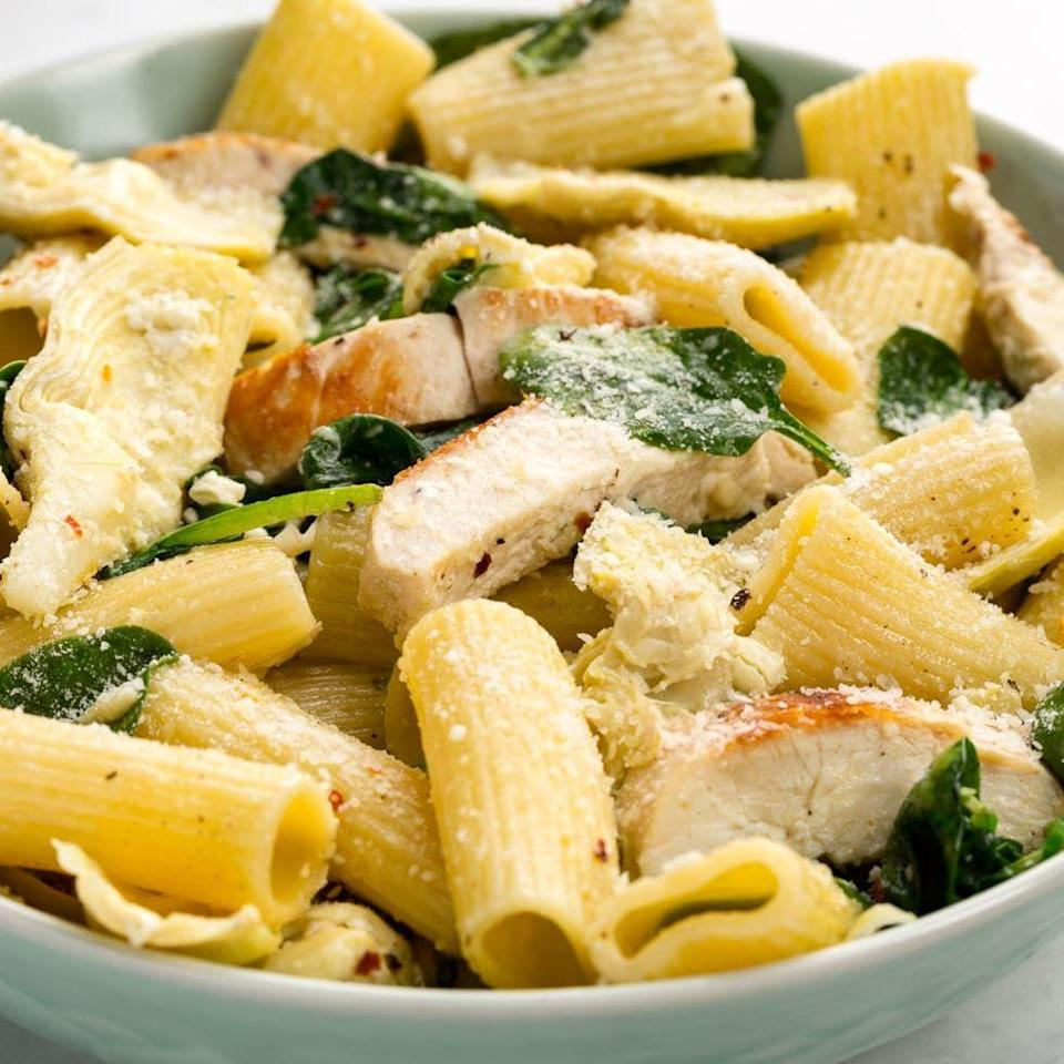 """<p>Your favourite dip deconstructed as a pasta? Yes, please.</p><p>Get the <a href=""""https://www.delish.com/uk/cooking/recipes/a35040907/chicken-spinach-and-artichoke-rigatoni-recipe/"""" rel=""""nofollow noopener"""" target=""""_blank"""" data-ylk=""""slk:Chicken, Spinach & Artichoke Pasta"""" class=""""link rapid-noclick-resp"""">Chicken, Spinach & Artichoke Pasta</a> recipe.</p>"""