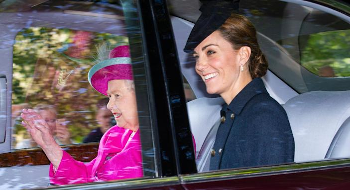 Kate Middleton sat next to the Queen as they travelled to a church service in Balmoral earlier today [Image: Getty]