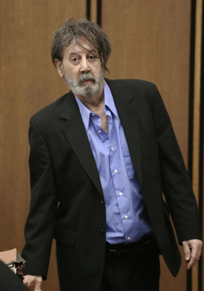 Bobby Thompson, who authorities have identified as Harvard-trained attorney John Donald Cody, enters the courtroom Wednesday, Nov. 13, 2013, in Cleveland. Thompson is charged with looting the United States Navy Veterans Association, a charity he ran from Tampa, Fla. The charity fraudulently registered with the state of Ohio in 2003 and made annual renewals, the prosecutor said. The charges include racketeering, money laundering, theft and identity theft.(AP Photo/Tony Dejak)