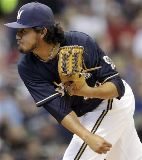 Milwaukee Brewers starting pitcher Yovani Gallardo throws during the first inning of a baseball game against the Colorado Rockies, Sunday, April 22, 2012, in Milwaukee. (AP Photo/Morry Gash)