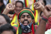 A man shouts anti-government slogans during a protest against farm bills in Bengaluru, India, Monday, Sept. 28, 2020. Indian lawmakers earlier this month approved a pair of controversial agriculture bills that the government says will boost growth in the farming sector through private investments. (AP Photo/Aijaz Rahi)