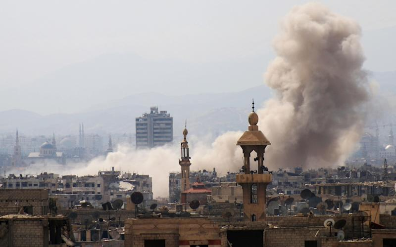 Smoke billows up from Damascus in the wake of the fighting - AFP or licensors