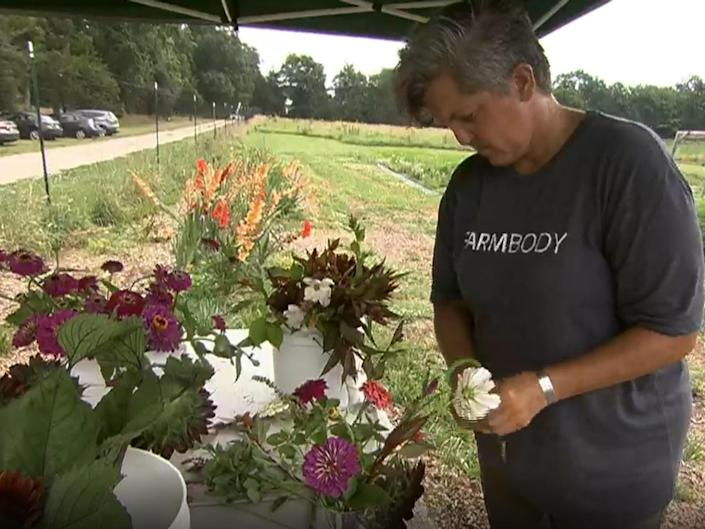 Jennie Haskamp learned how to harvest flowers. / Credit: CBS News