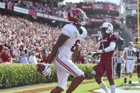 FILE - In this Sept. 14, 2019, file photo, Alabama's DeVonta Smith reacts after scoring a touchdown during the first half of an NCAA college football game against South Carolina, in Columbia, S.C. Smith was selected to The Associated Press All-Southeastern Conference football team, Monday, Dec. 9, 2019. (AP Photo/Richard Shiro, File)
