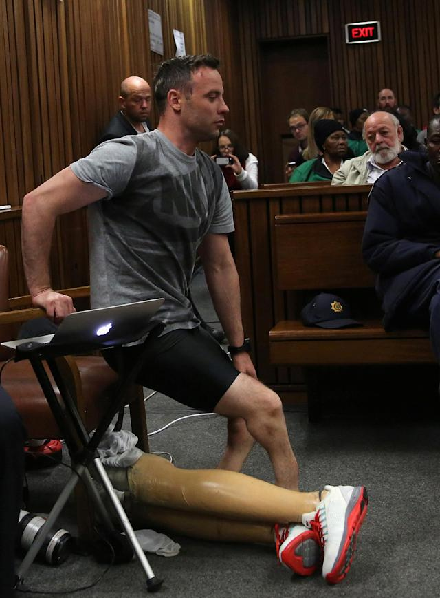 Barry Steenkamp (R), father of Reeva Steenkamp watches as Paralympic gold medalist Oscar Pistorius prepares to walks across the courtroom on stumps during the third day of the resentencing hearing for the 2013 murder of his girlfriend Reeva Steenkamp, at Pretoria High Court, South Africa June 15, 2016. REUTERS/Siphiwe Sibeko