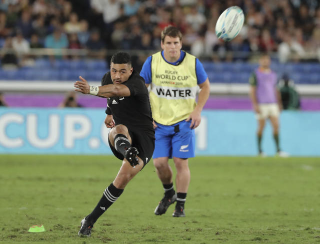 CORRECTS NAME: New Zealand's Richie Mounga kicks a goal during their match against South Africa at the Rugby World Cup Pool B game in Yokohama, Japan, Saturday, Sept. 21, 2019. (AP Photo/Koji Sasahara)