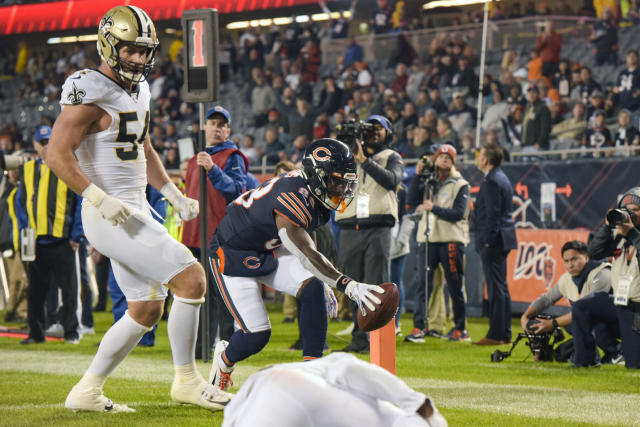 Chicago Bears wide receiver Javon Wims (83) scores a touchdown in front of New Orleans Saints outside linebacker Kiko Alonso (54) during the second half of an NFL football game in Chicago, Sunday, Oct. 20, 2019. (AP Photo/Mark Black)