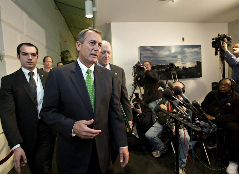 "Speaker of the House John Boehner, R-Ohio, walks with House Ways and Means Committee Chairman Dave Camp, R-Mich., following a closed-door GOP meeting as the ""fiscal cliff"" bill passed by the Senate Monday night waits for a vote in the Republican-controlled House, at the Capitol in Washington, Tuesday Jan. 1, 2013.  (AP Photo/J. Scott Applewhite)"