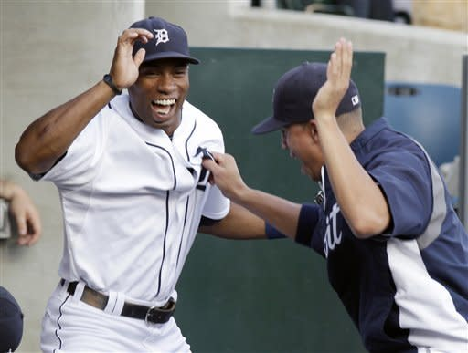 Detroit Tigers' Austin Jackson, left, and Quintin Berry go through a pregame routine before a baseball game against the Los Angeles Angels, Friday, Aug. 24, 2012, in Detroit. (AP Photo/Duane Burleson)