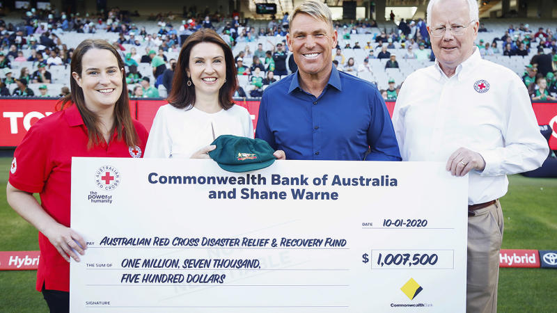 Shane Warne, pictured here with his Baggy Green cap after raising over $1 million for bushfire victims.