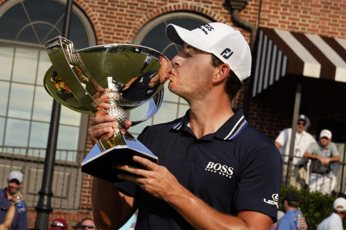 Patrick Cantlay kisses the trophy after winning the Tour Championship golf tournament and the FedEx Cup at East Lake Golf Club, Sunday, Sept. 5, 2021, in Atlanta. (AP Photo/Brynn Anderson)