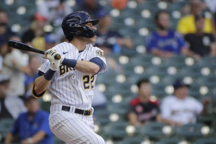 Milwaukee Brewers' Christian Yelich watches his solo home run during the eighth inning of a baseball game against the Arizona Diamondbacks, Saturday, June 5, 2021, in Milwaukee. (AP Photo/Aaron Gash)
