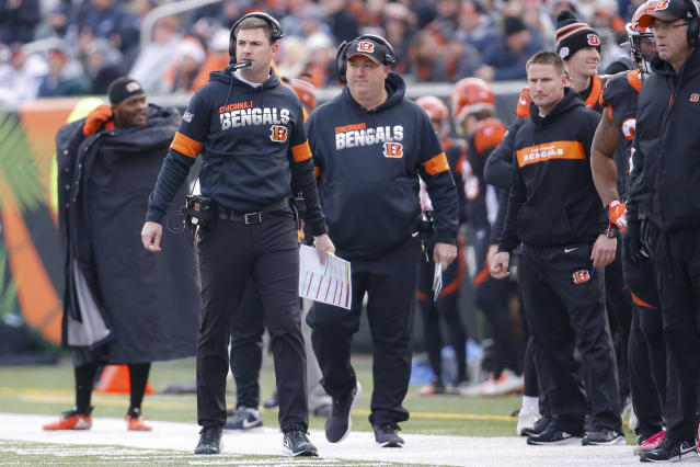 Cincinnati Bengals head coach Zac Taylor, left, works the sidelines in the first half of an NFL football game against the New England Patriots, Sunday, Dec. 15, 2019, in Cincinnati. (AP Photo/Frank Victores)
