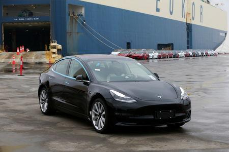 A Tesla Model 3 car leaves a cargo vessel at a port in Shanghai, China February 22, 2019. REUTERS/Stringer