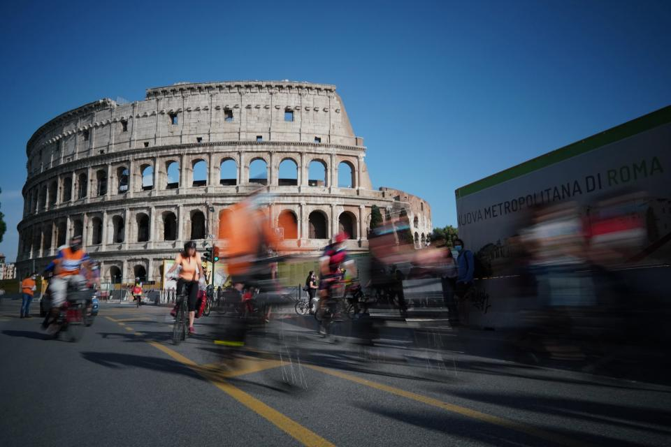 FILE - In this Friday, June 5, 2020 file photo, people cycle during a demonstration in front of the ancient Colosseum in Rome. The European Union on Wednesday, May 19, 2021 took a step toward relaxing tourism travel for visitors from outside the bloc, with EU ambassadors agreeing on measures to allow fully vaccinated visitors in. They also agreed on easing the criteria for nations to be considered a safe country, from which all tourists can travel. Up to now, that list included only seven nations. (AP Photo/Andrew Medichini, File)