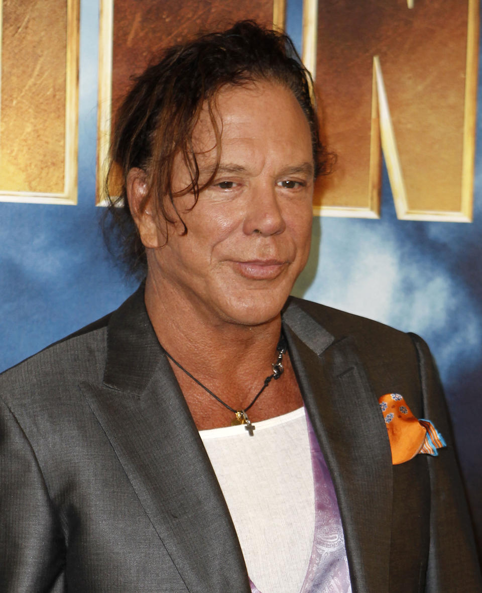Actor Mickey Rourke poses for photographers during a photo call for the upcoming film