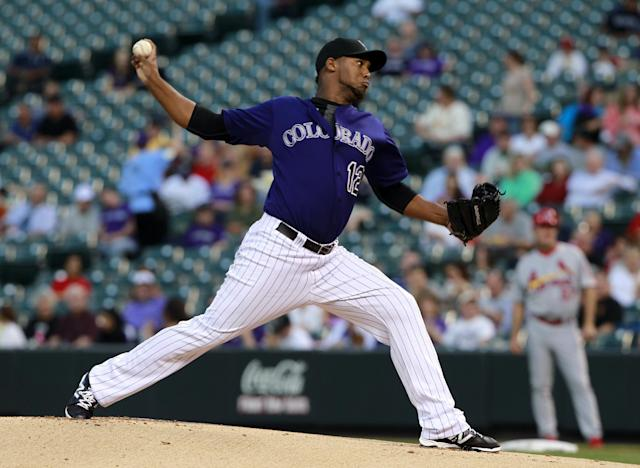 Colorado Rockies starting pitcher Juan Nicasio delivers against the St. Louis Cardinals in the first inning of a baseball game in Denver on Tuesday, Sept. 17, 2013. (AP Photo/David Zalubowski)