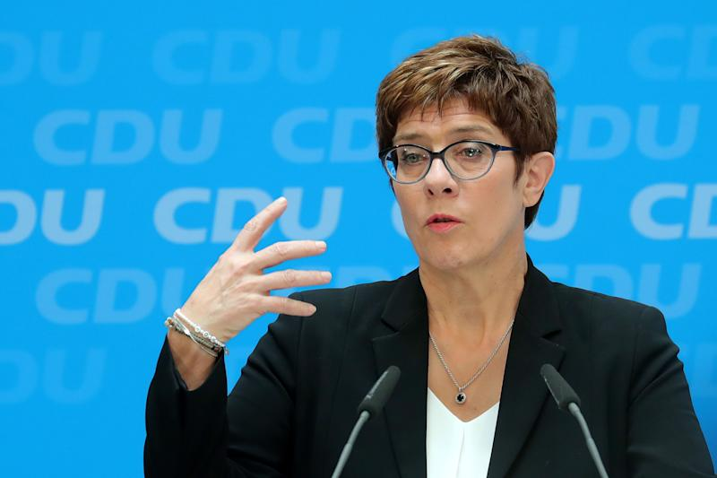 """(Bloomberg) -- Angela Merkel's would-be successor is gambling that one of Germany's riskier cabinet jobs will help get her chances of becoming chancellor back on track.In an unexpected about-face, Annegret Kramp-Karrenbauer will take command of Germany's military as defense minister. It's a position that has ended several political careers in the past, though her predecessor, Ursula von der Leyen, just landed the job of leading the European Commission in Brussels.Kramp-Karrenbauer, known as AKK in Berlin, had previously said she would steer clear of Merkel's cabinet, preferring to distance herself from a coalition government that's fraying at the seams. Instead, she planned to build her case to replace Merkel after the next election, due in 2021, from her position as leader of the Christian Democratic Union.But AKK has struggled to boost the fortunes of the CDU since taking charge in December. She fumbled with overtures to the party's right wing and saw a slide in the polls. As of May, Merkel had grown more determined to stay in office amid doubts that AKK was up to the job, according to party officials close to the chancellor.By opting to take over Germany's fighting forces, Kramp-Karrenbauer exchanges her independence for a position that could be the ultimate proving ground for her abilities.""""If you want to show leadership you don't think about the risk, you just get on with the job,"""" Ralph Brinkhaus, head of the CDU parliamentary caucus, said in an interview with ZDF television Wednesday. """"In life, just as in politics, there are always risks, but if you don't trust yourself to take on difficult tasks, then you don't belong in politics.""""Trump's Spending DemandsKramp-Karrenbauer's decision was already exposing fresh tensions between the CDU-led bloc and its Social Democratic coalition partner. SPD lawmaker Johannes Kahrs, a senior party official on the parliamentary budget committee, took aim at AKK for going back on her word not to join the cabinet and for lacking"""