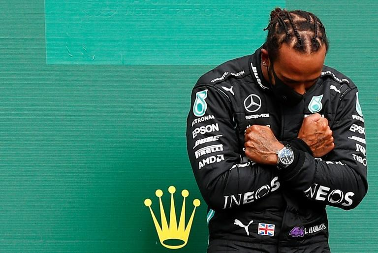 Paying tribute: Lewis Hamilton imitated the late Chadwick Boseman's Black Panther pose on the podium