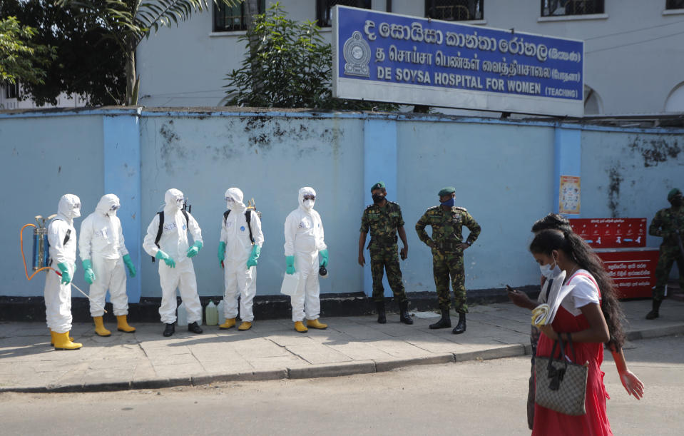 Sri Lankan police commandos prepare to spray disinfectants in a hospital in Colombo, Sri Lanka, Friday, March 27, 2020. The new coronavirus causes mild or moderate symptoms for most people, but for some, especially older adults and people with existing health problems, it can cause more severe illness or death. (AP Photo/Eranga Jayawardena)