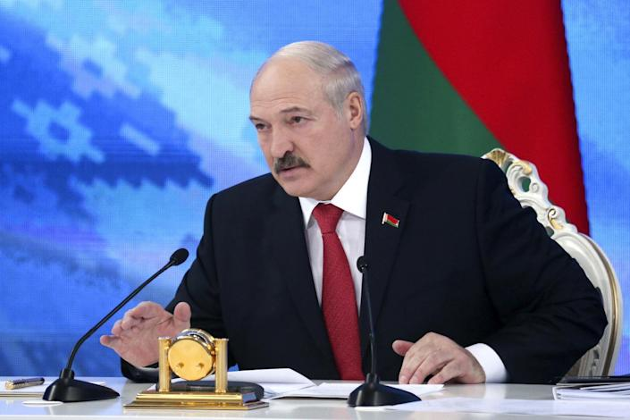 "Belarus's President Alexander Lukashenko speaks during a briefing in Minsk, Belarus, Friday, Feb. 3, 2017. In a televised broadcast on Friday, Lukashenko asked the country's interior minister to press charges against Russia's top food safety official, alleging charges of ""damaging the state"" because Russia stopped the import of Belarusian products due to quality issues and suspicions that Belarus resells EU-made dairy products that are banned in Russia. The Kremlin responded to the outburst, listing the loans and reduced taxes that Russia gave to Belarus. (Maxim Guchek/BelTA Pool Photo via AP)"