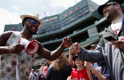 Boston Red Sox's Hanley Ramirez greets fans before a baseball game against the Baltimore Orioles in Boston, Sunday, May 20, 2018. (AP Photo/Michael Dwyer)