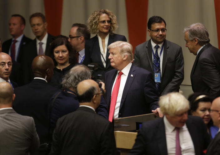 <p>United States President Donald Trump, center, makes his way through diplomats and others after a meeting during the United Nations General Assembly at U.N. headquarters, Monday, Sept. 18, 2017. (Photo: Seth Wenig/AP) </p>