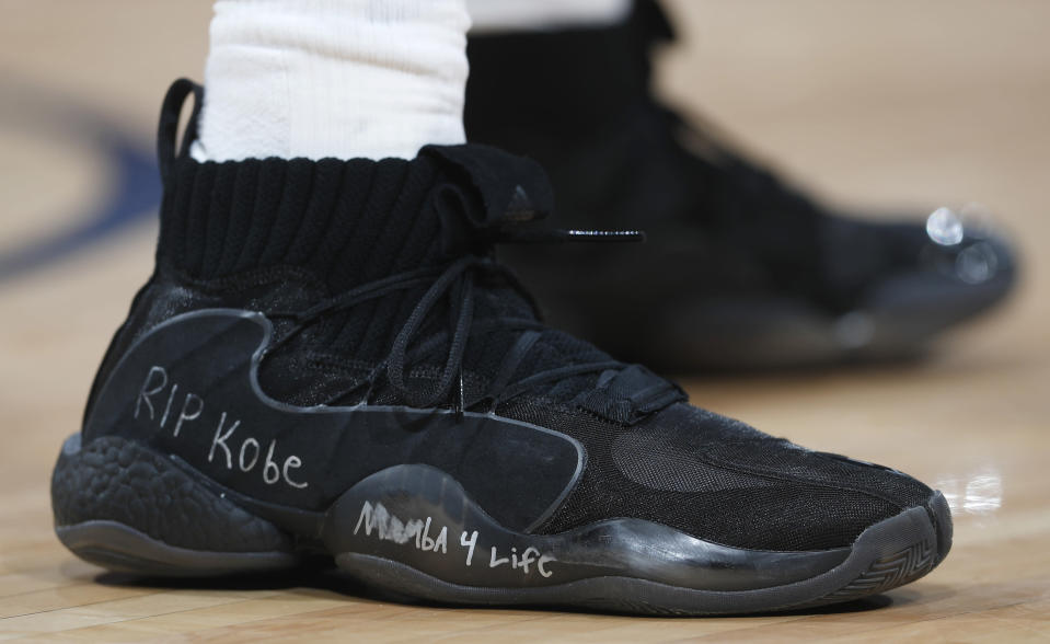 Houston Rockets guard Austin Rivers wears a pair of Adidas Crazy Eights with a tribute to Kobe Bryant written on the midsole in the second half of an NBA basketball game against the Denver Nuggets, Sunday, Jan. 26, 2020, in Denver. The Nuggets won 117-110. (AP Photo/David Zalubowski)