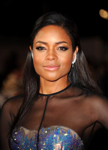 """Actress Naomie Harris poses at the world premiere of """"Skyfall"""" on Tuesday, Oct. 23, 2012 in London. (Photo by Stewart Wilson/Invision/AP)"""
