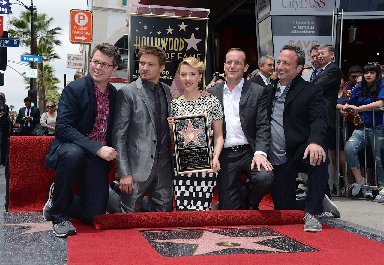 HOLLYWOOD, CA - MAY 02: (L-R) Executive Producer Jeremy Latcham, actors Jeremy Renner and Clark Gregg pose with actress Scarlett Johansson of 'Marvel's The Avengers' (C) as she is honored on the Hollywood Walk of Fame on May 2, 2012 in Hollywood, California.   (Photo by Jason Merritt/Getty Images)