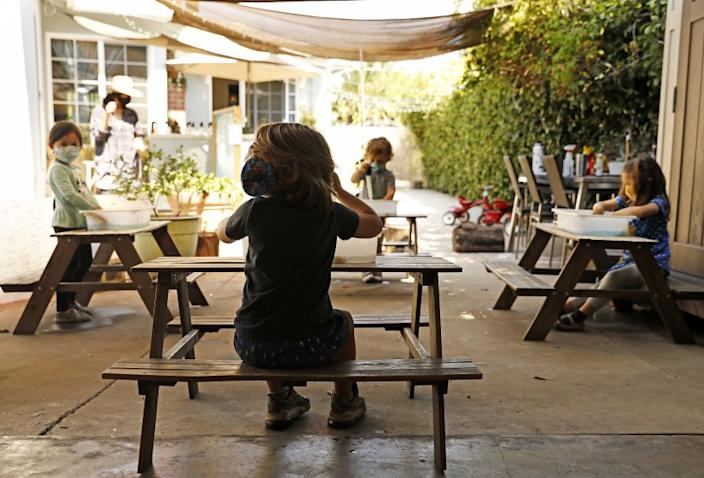 LOS ANGELES-AUGUST 27, 2020: Children do activities at separate tables at Voyages Preschool in Los Angeles on Thursday, August 27, 2020. (Christina House / Los Angeles Times)