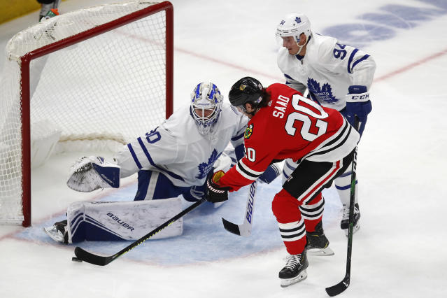 Toronto Maple Leafs' Michael Hutchinson, left, makes a save on Chicago Blackhawks' Brandon Saad, as Maple Leafs' Tyson Barrie watches during the third period of an NHL hockey game Sunday, Nov. 10, 2019, in Chicago. (AP Photo/Jim Young)