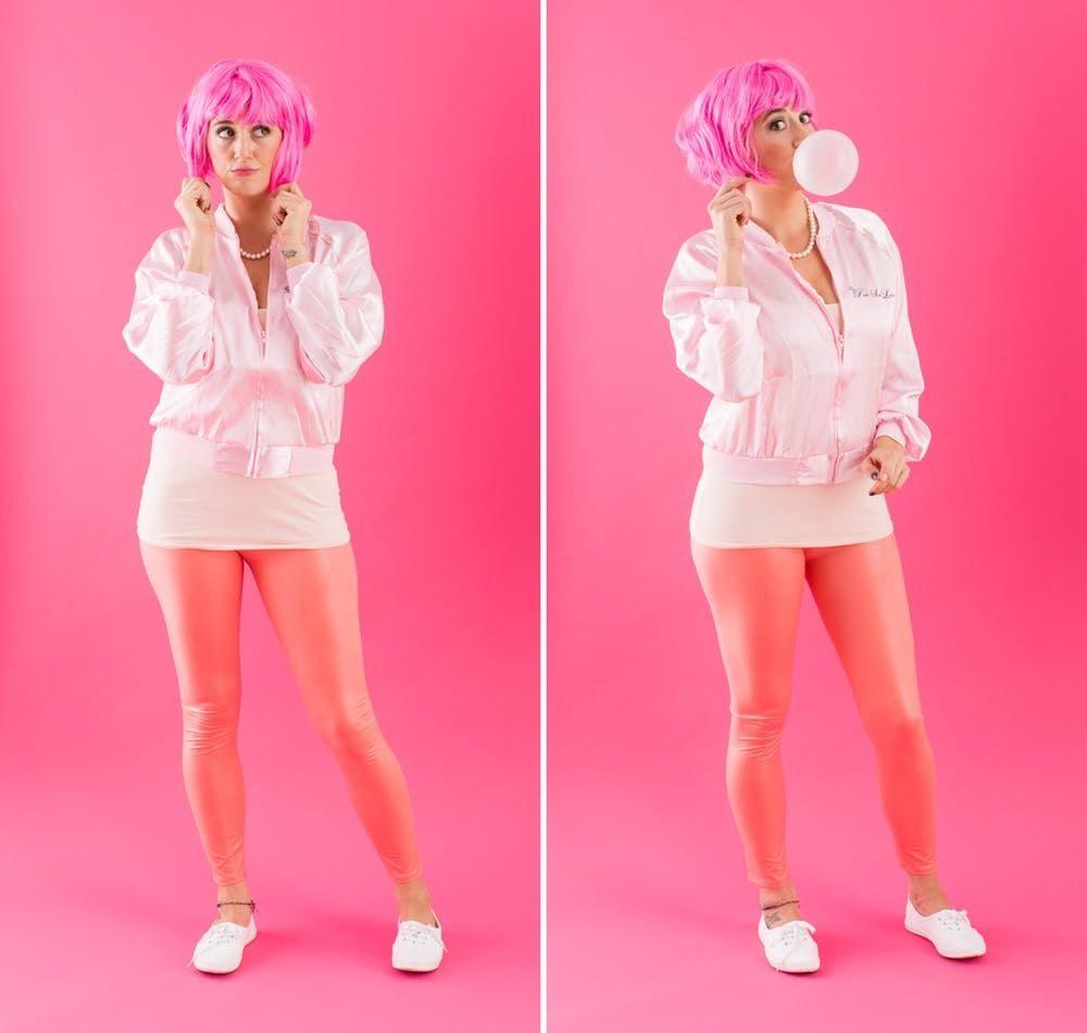 """<p>Calling all beauty school dropouts with a penchant for the color pink! We're pretty sure we just found your dream costume...</p><p><strong>Get the tutorial at <a href=""""https://www.brit.co/wig-halloween-costumes/"""" target=""""_blank"""">Brit + Co</a>. </strong></p><p><a class=""""body-btn-link"""" href=""""https://www.amazon.com/Smiffys-42127-Frenchy-Wig-Pink/dp/B00E2REPBC?tag=syn-yahoo-20&ascsubtag=%5Bartid%7C10050.g.22473796%5Bsrc%7Cyahoo-us"""" target=""""_blank"""">SHOP PINK WIGS</a></p>"""