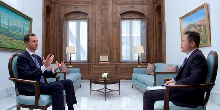Syria's President Bashar al-Assad speaks during an interview with Chinese TV station Phoenix in Damascus