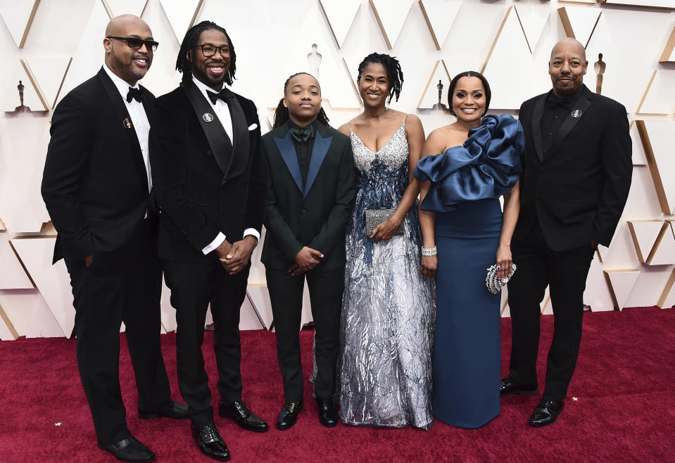 """Matthew A. Cherry, from second left, Deandre Arnold, his mother Sandy Arnold, second right, and the cast and the crew of """"Hair Love"""" arrive at the Oscars on Sunday, Feb. 9, 2020, at the Dolby Theatre in Los Angeles. (Photo by Jordan Strauss/Invision/AP)"""