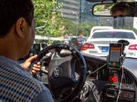Uber competitor DiDi's new reward system has slashed pay rates for Australian drivers, as they work punishing hours and battle it out for limited jobs