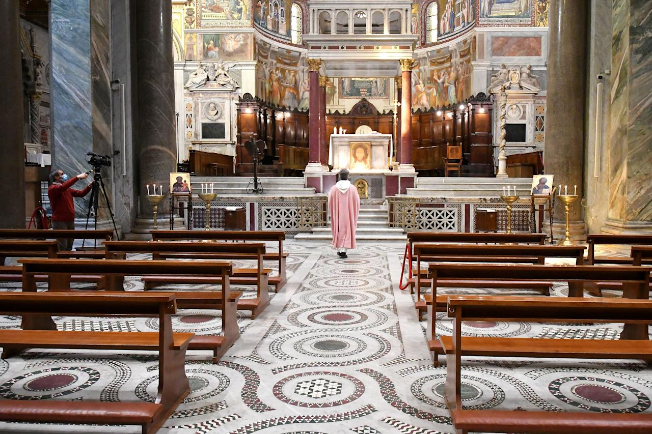 """Italy was one of the first countries to enter a <a href=""""https://www.cntraveler.com/story/italy-lockdown-coronavirus?mbid=synd_yahoo_rss"""">total lockdown</a>. Since then, some churches have remained open for individual prayer, but all public Masses are forbidden—in person, at least. Many services are available to worshippers via live streaming, like the one led by a parish priest in Rome's Santa Maria church (pictured)."""