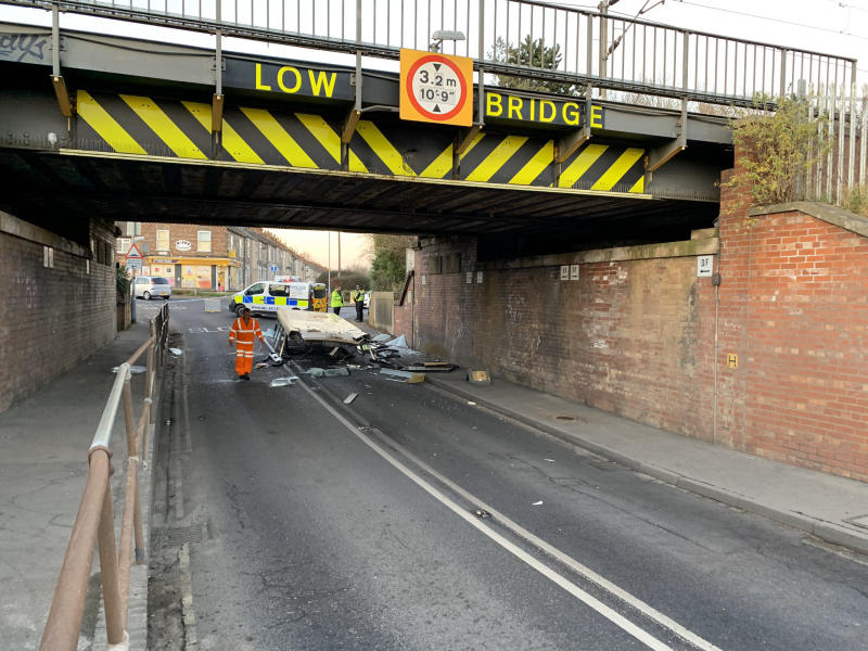"The bus roof ""peeled off"" when its driver attempted to pass under a low bridge (York Press/SWNS)"