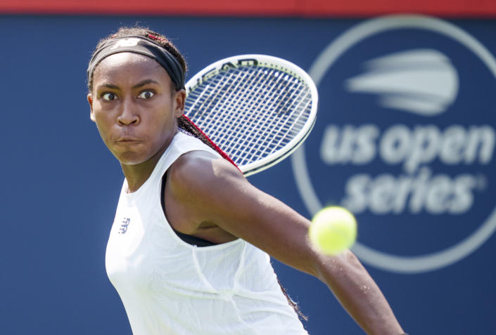 FILE - Coco Gauff eyes the ball to return to Anastasija Sevastova of Latvia at the National Bank Open tennis tournament in Montreal, in this Tuesday Aug. 10, 2021, file photo. Gauff is seeded for the U.S. Open, the year's last Grand Slam tennis tournament. Play in the main draw begins in New York on Monday, Aug. 30. (Paul Chiasson/The Canadian Press via AP, FIle)